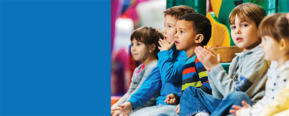 Week of the Young Child banner with image of young children sitting together watching something