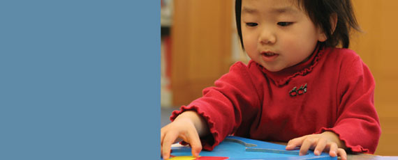 Photo of child doing puzzle