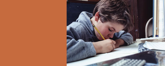 Photo of boy writing