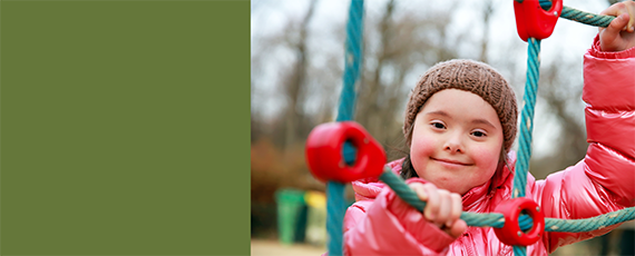 banner image featuring smiling child playing on an outdoor playground