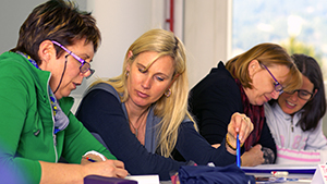 Photo of a group of women working together at a table