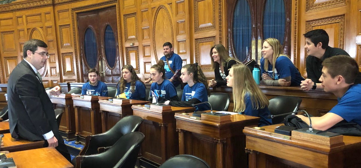 image of students meeting with a legislator in the state house