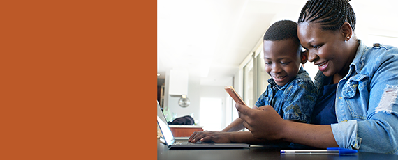banner image of parent and child looking at a computer and smart phone