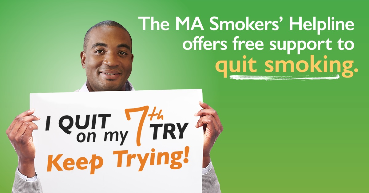 "image of a man holding a sign that says ""I quite on my 7th try. Keep trying!"" with text above him ""The MA Smokers' Helpline offers free support to quit smoking."""